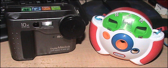 My first digital camera and my son's first digital camera - equals